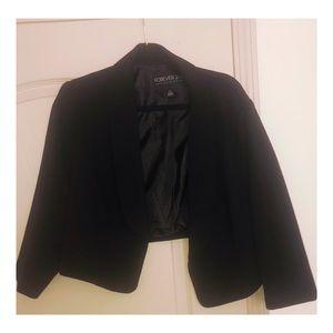 Black crop blazer.